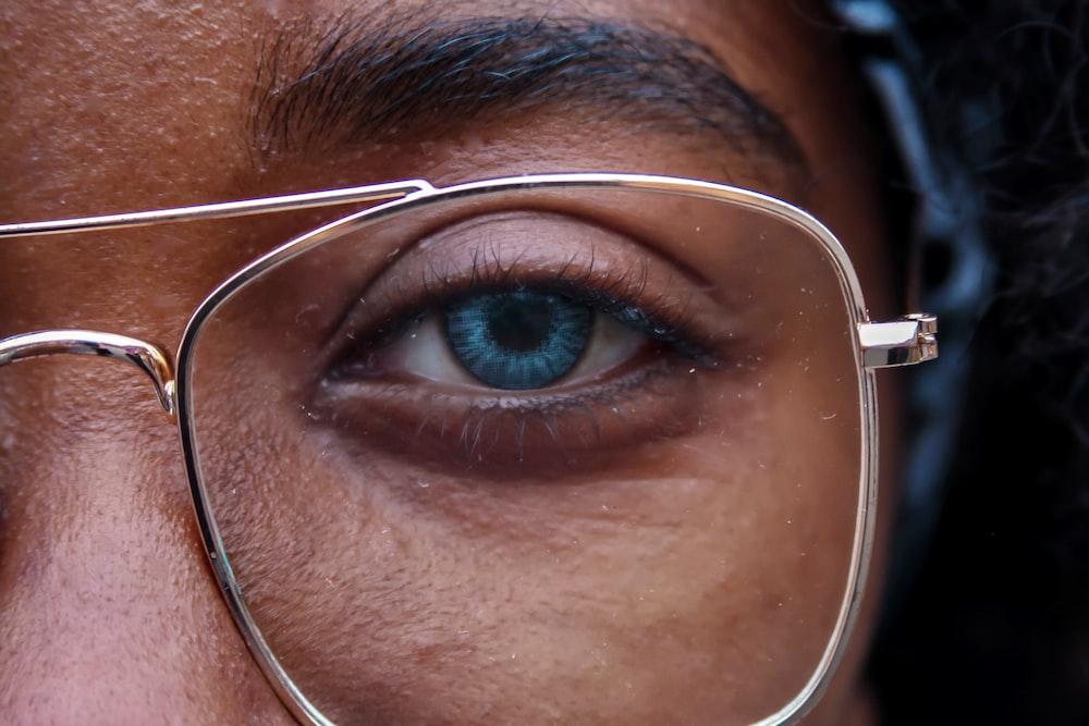 woman wearing grey frame eyeglasses