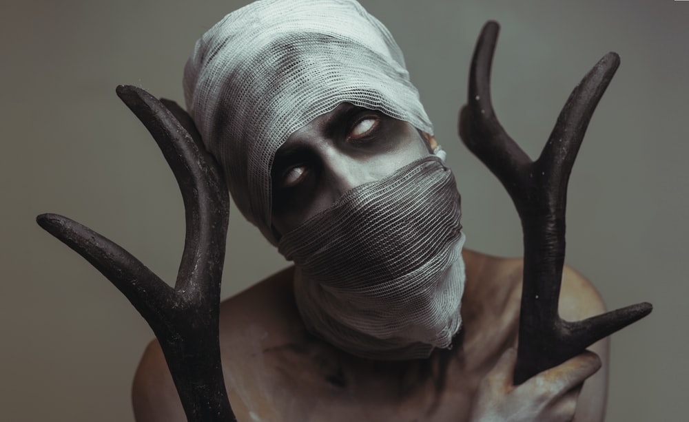 man holding antler horns