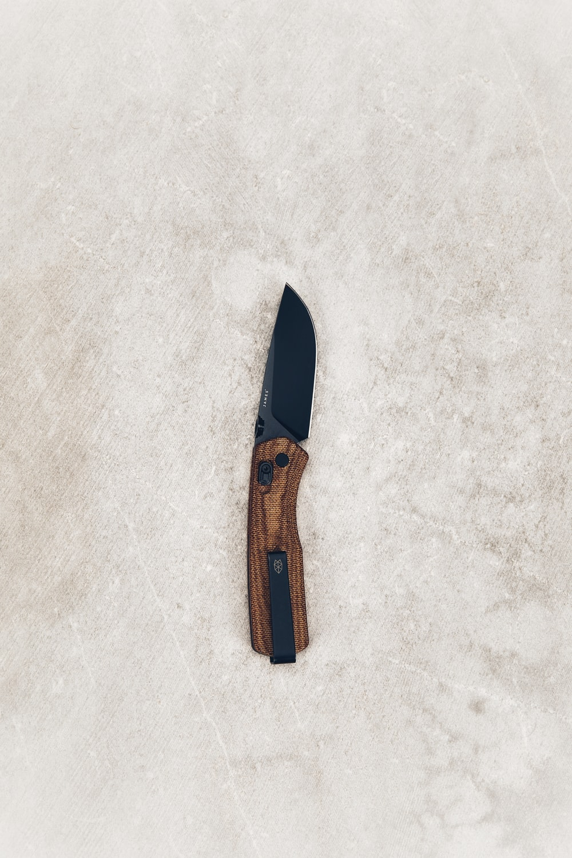black and brown pocketknife