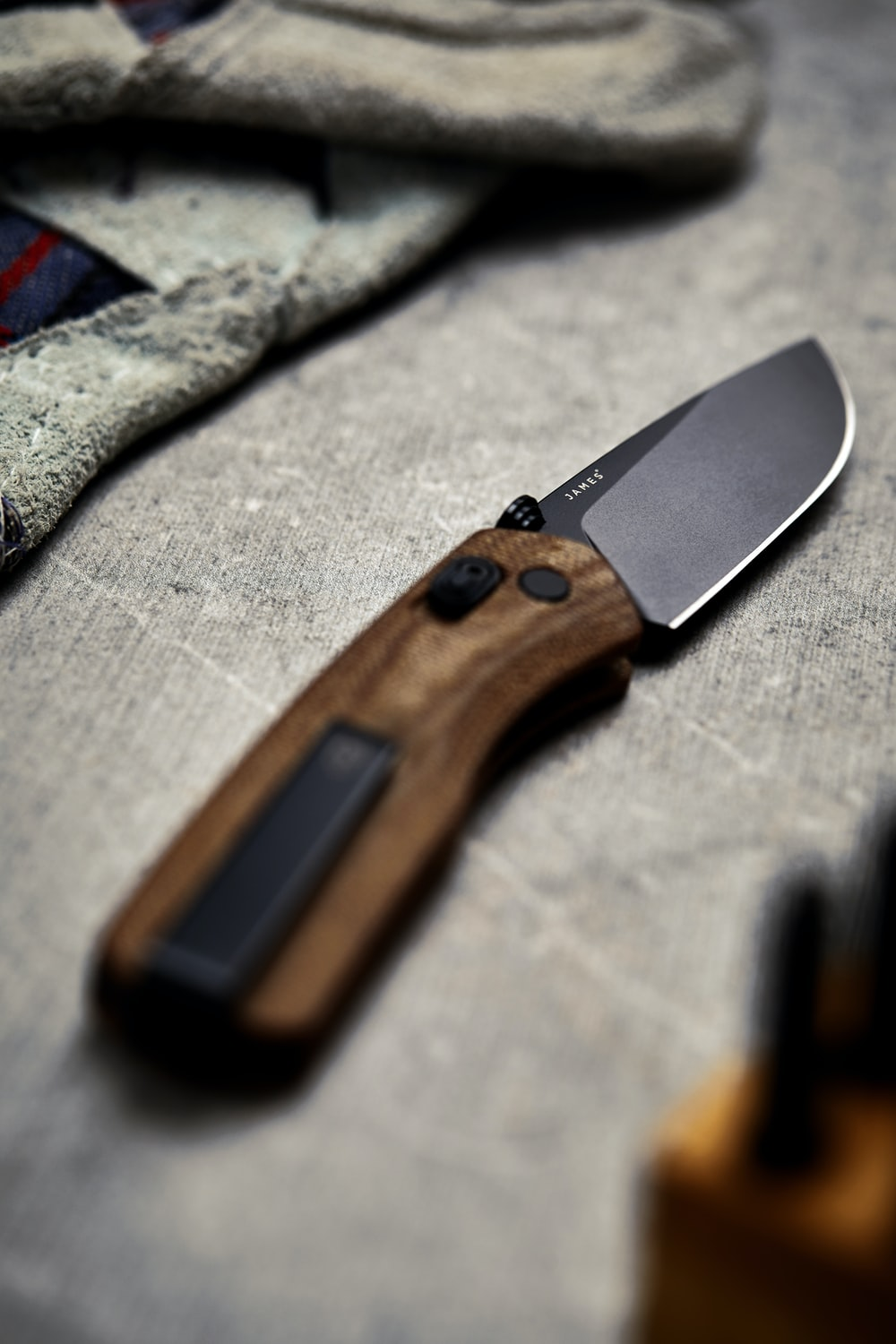 brown and black pocketknife