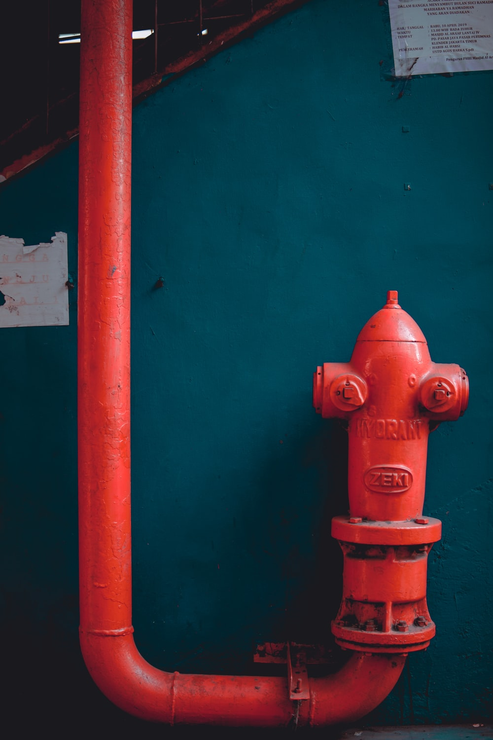 red pipe on wall