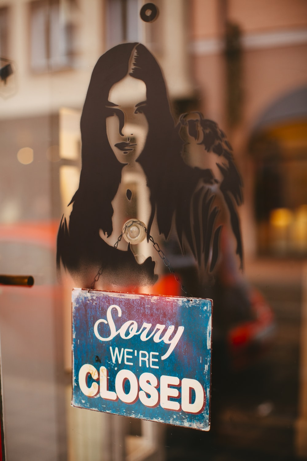 selective focus photography of Sorry We're Closed sign
