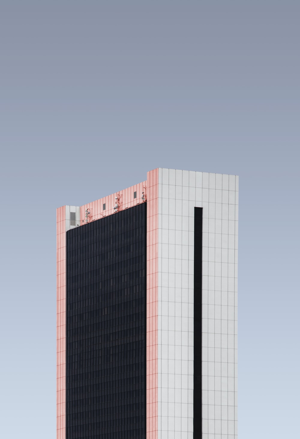 gray and black concrete high-rise building during daytime