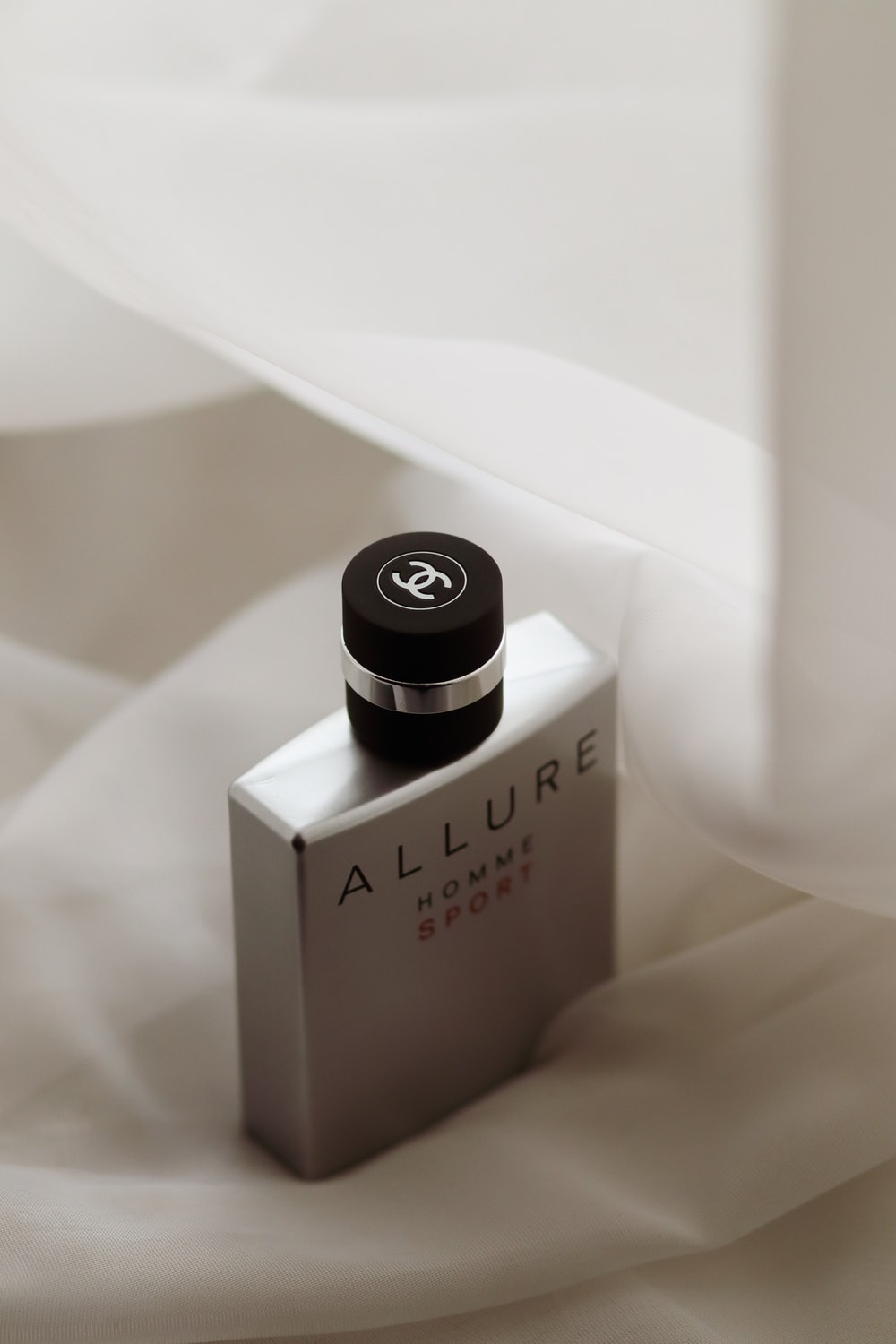 selective focus photography of Allure Homme fragrance bottle