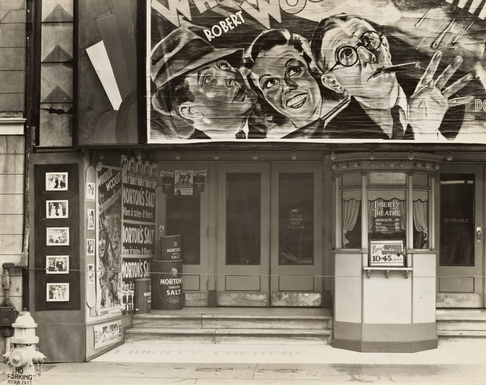 grayscale photography of storefront