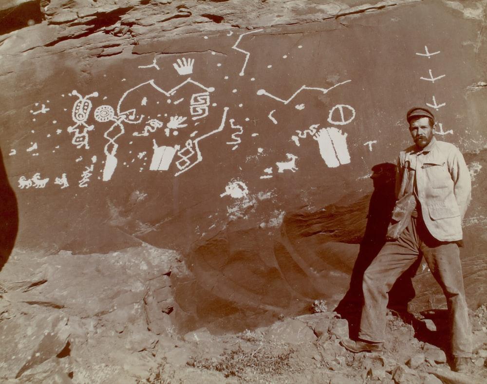 man standing beside rock in Glen Canyon