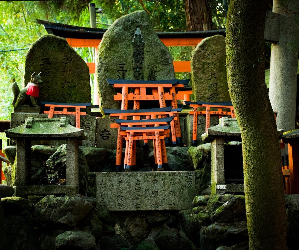 red-and-black mini tori gates on stones