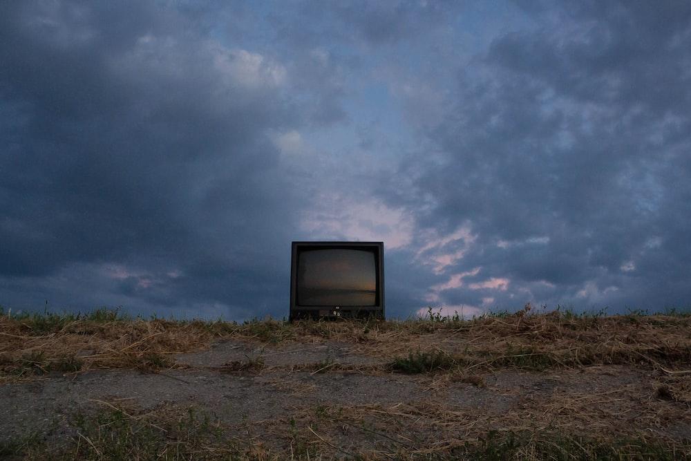 black CRT television on soil