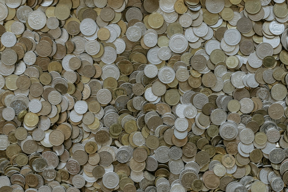 round silver-and-gold-colored coin collection