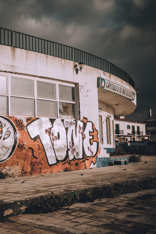 white and orange grafitti