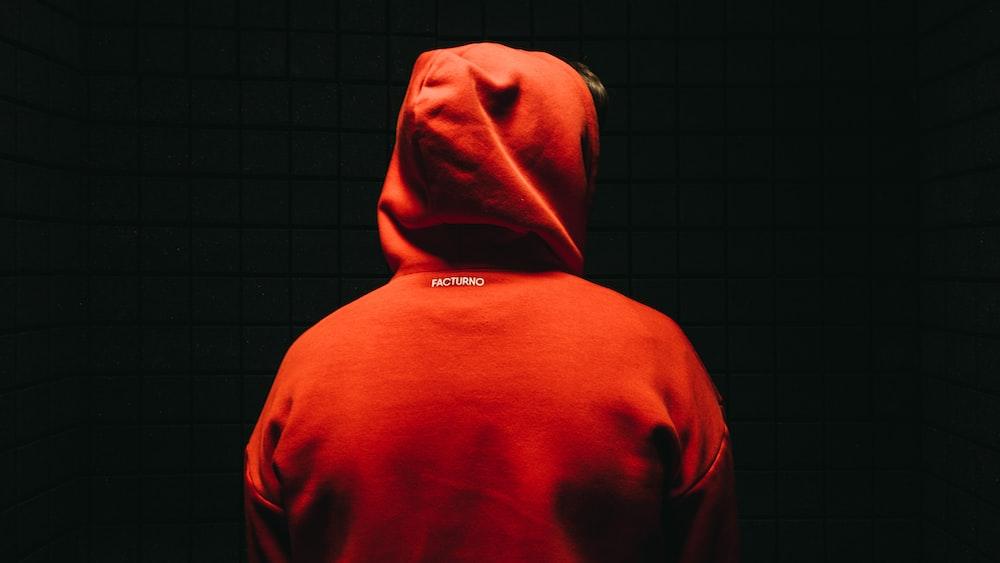 person wearing orange jacket