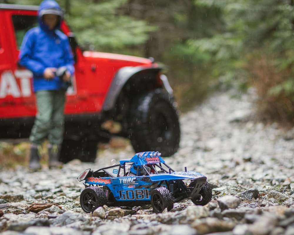 blue and black toy car on rocks