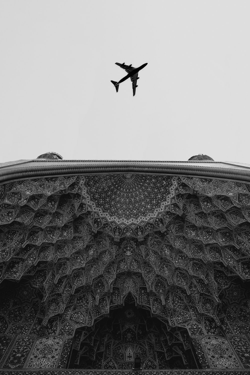 grayscale photography of flying plane during daytime