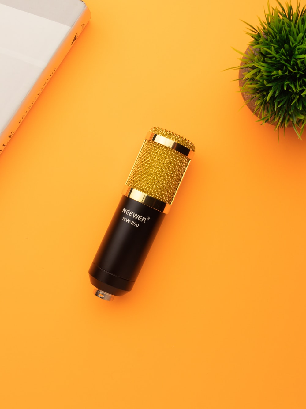 black and silver microphone on orange table