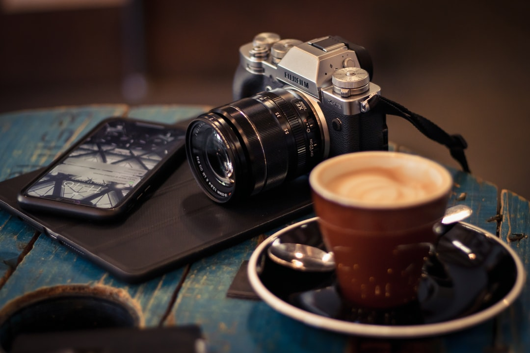Camera and Coffee On Table - unsplash