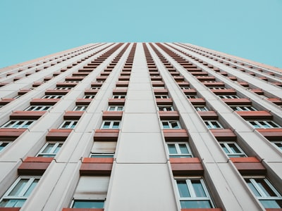 white and brown high-rise building during daytime