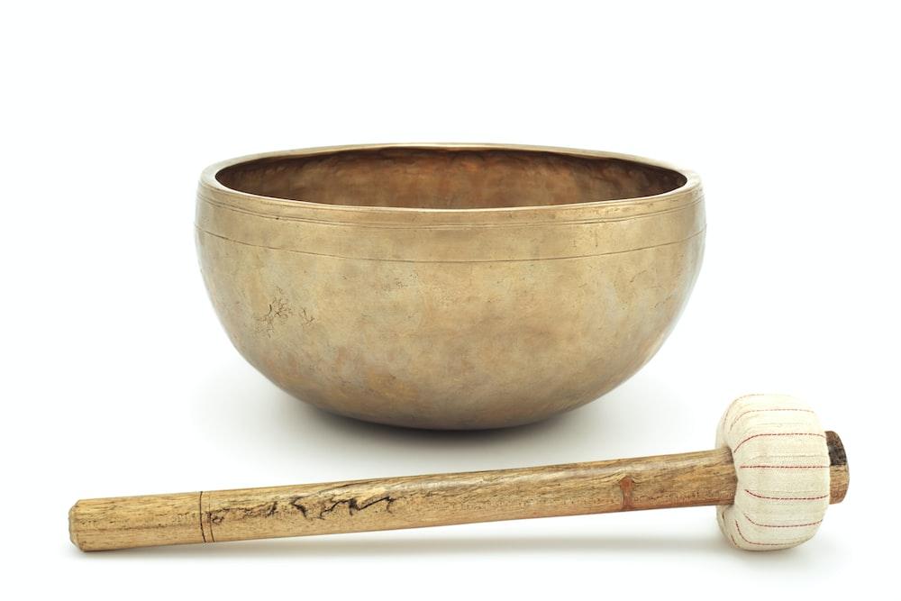 brown wooden spoon on brown ceramic bowl