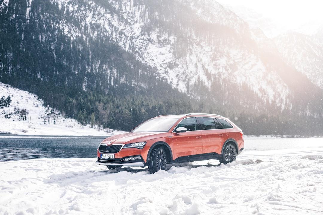 Brown Car On Snow Field - unsplash