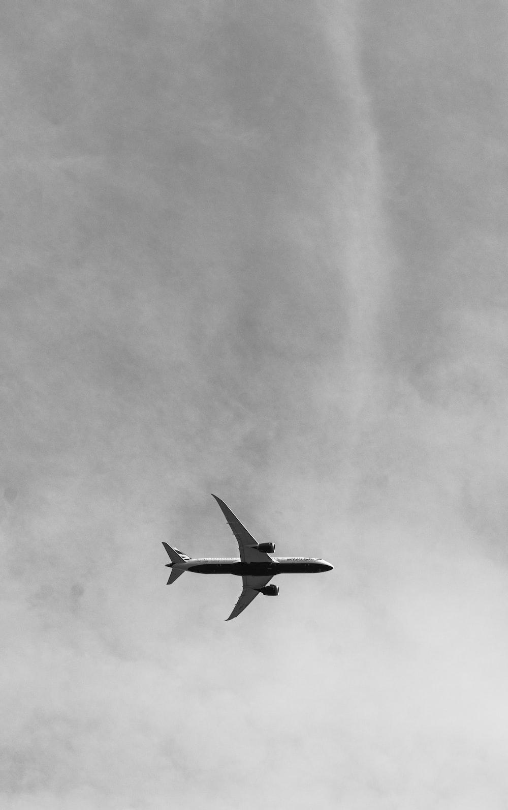 white airliner on sky