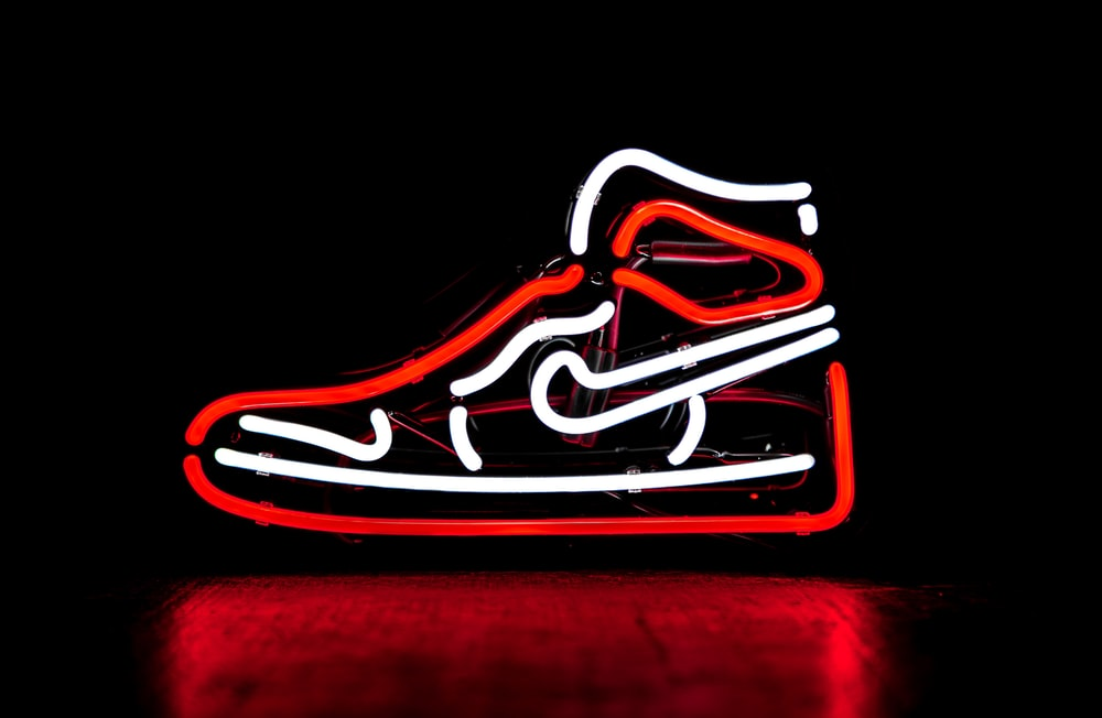 red and white Nike basketball shoe neon signage