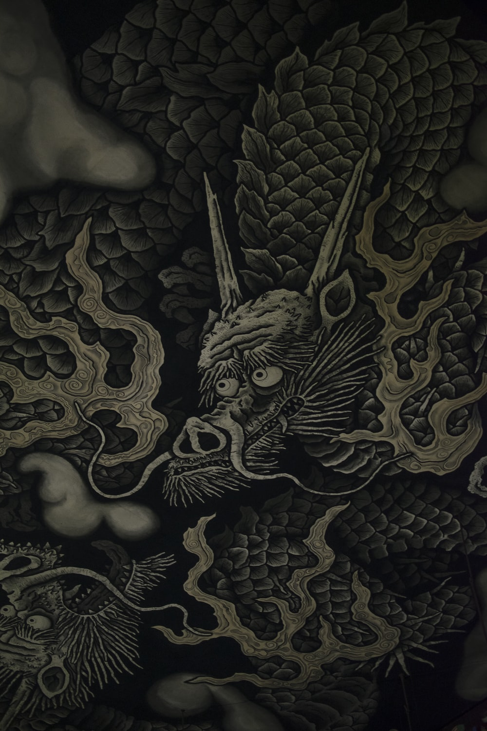 black and beige dragon-printed textile