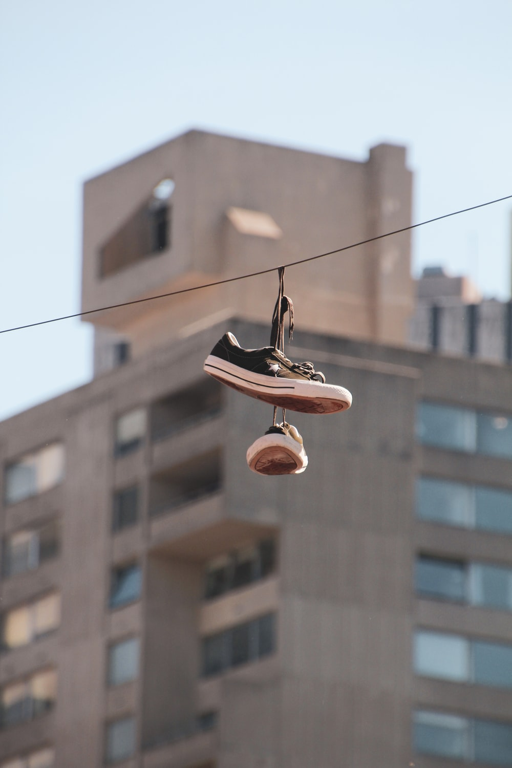 shoes hanging on clothesline