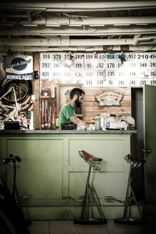 man sitting inside counter