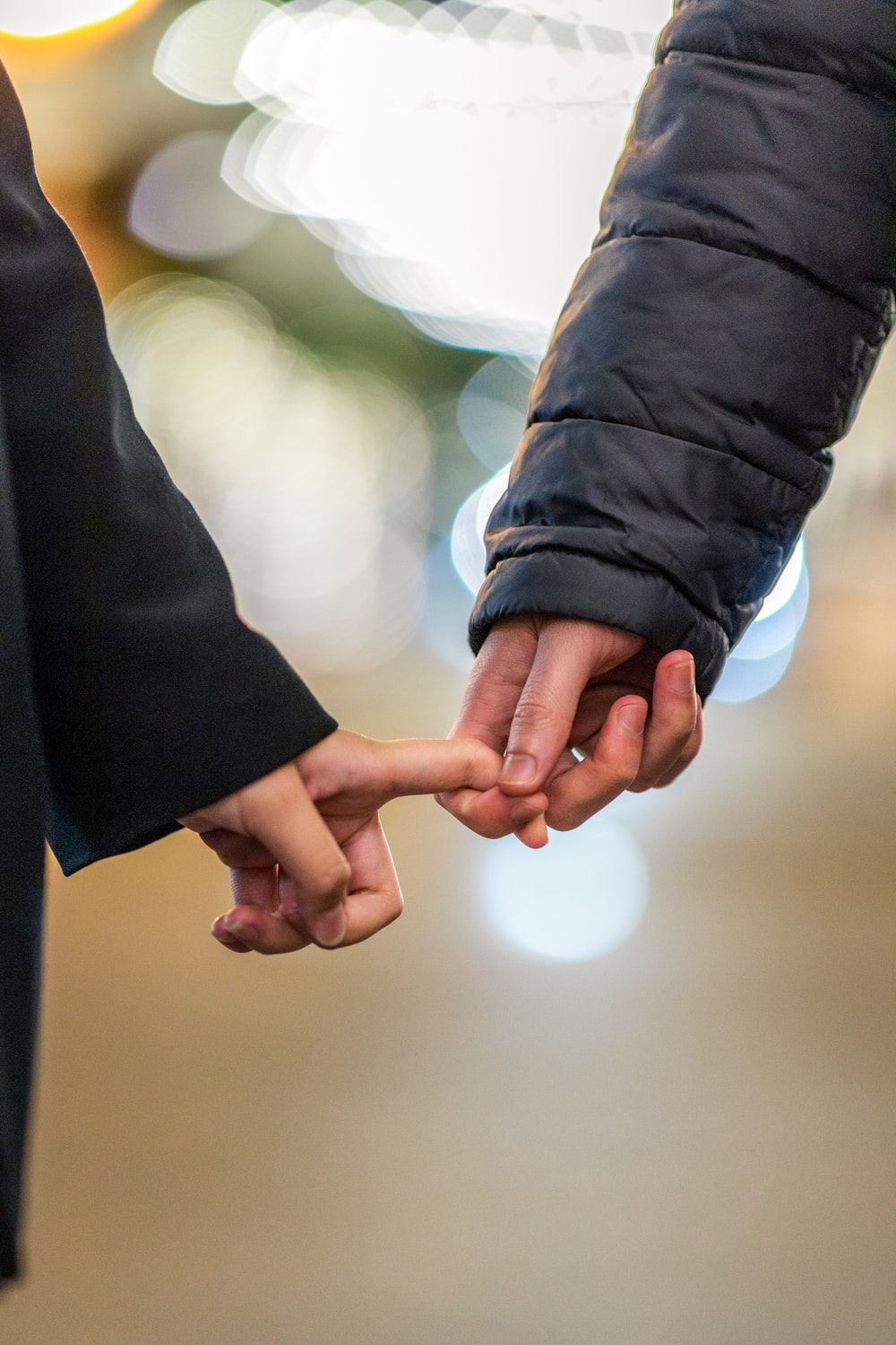 two people holding each others hands