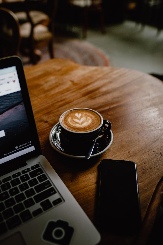 coffee in black ceramic teacup