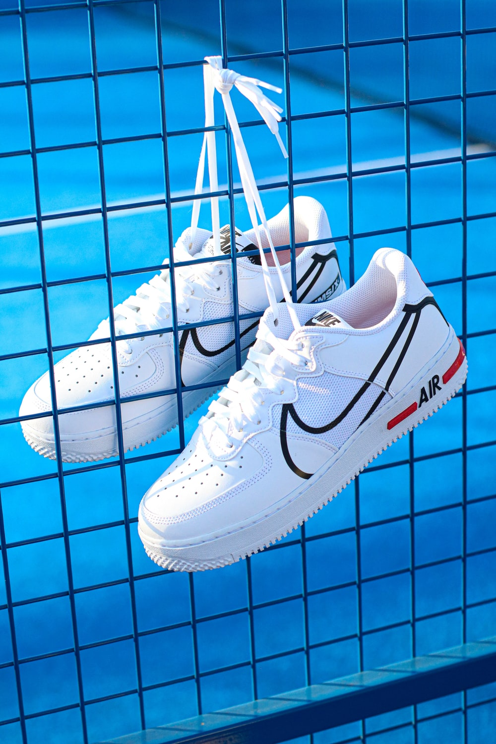 pair of white Nike low-top shoes