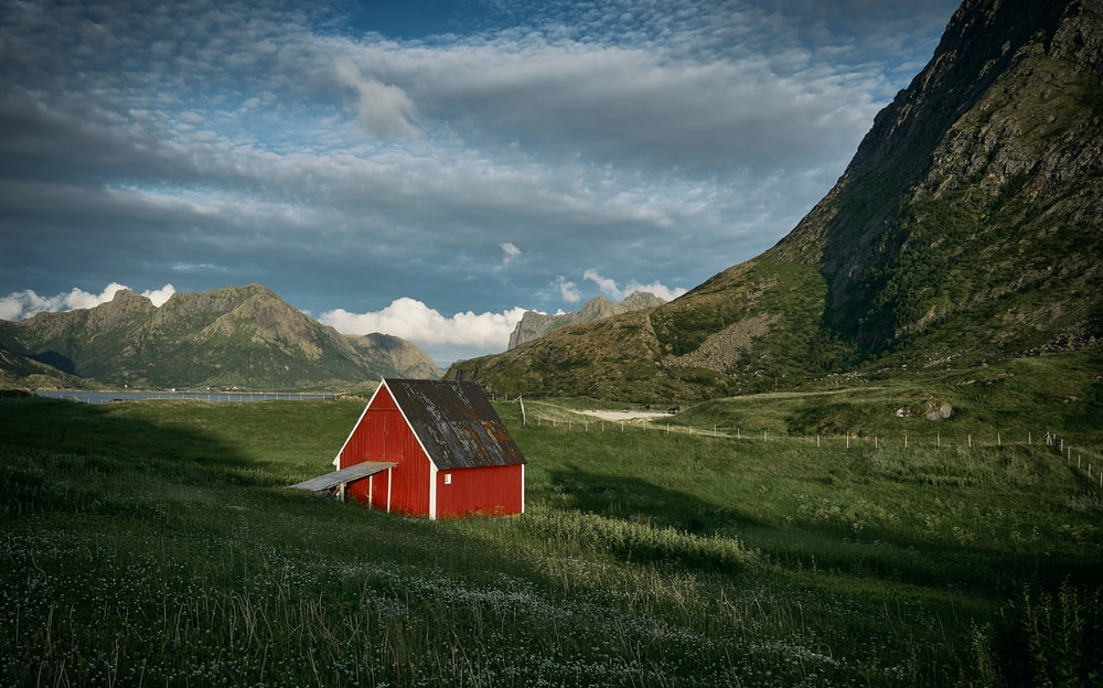 red house on field