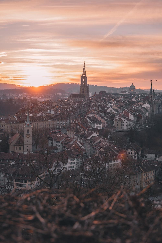 city skyline during sunset with orange sky