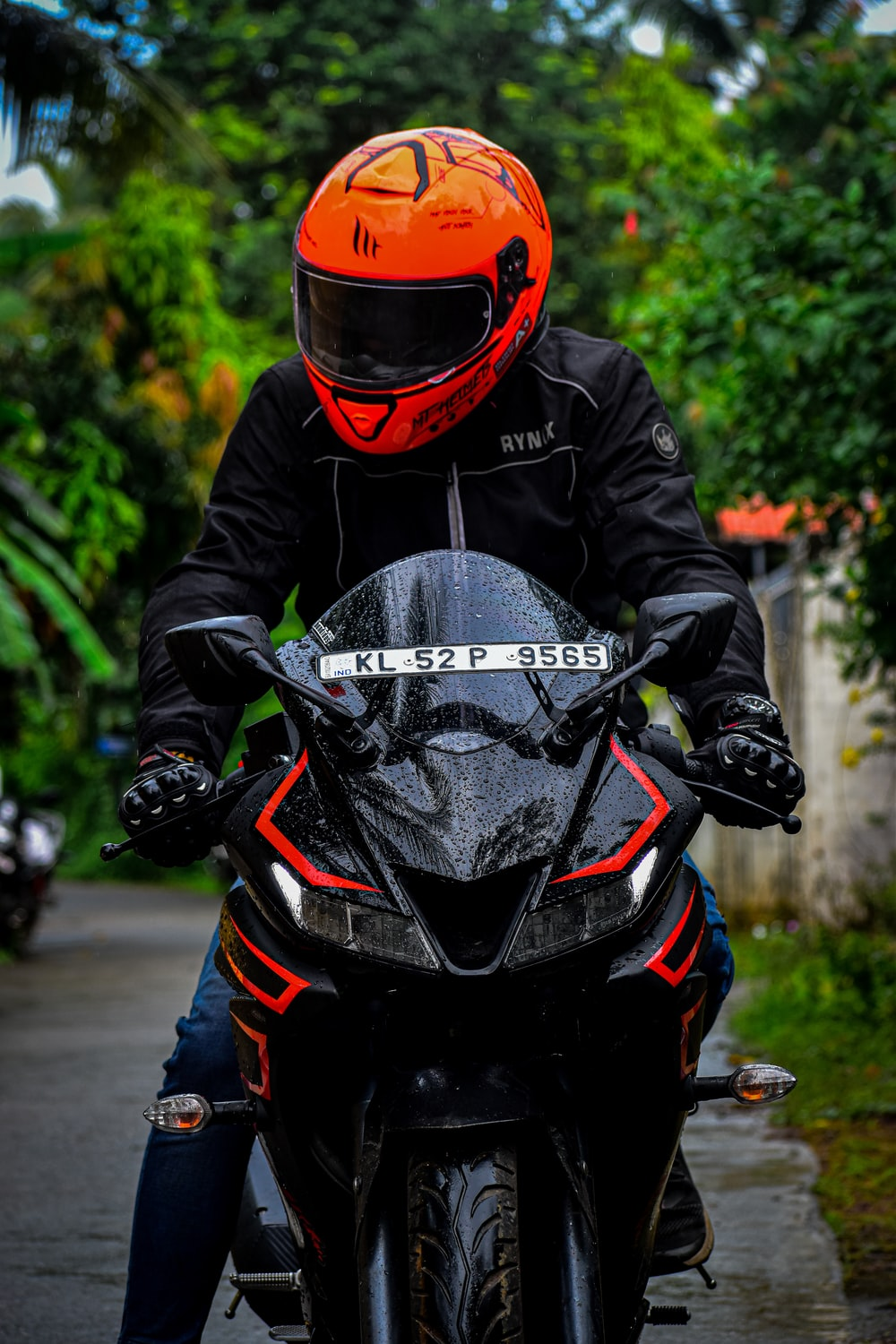 person in black and red motorcycle helmet and black jacket