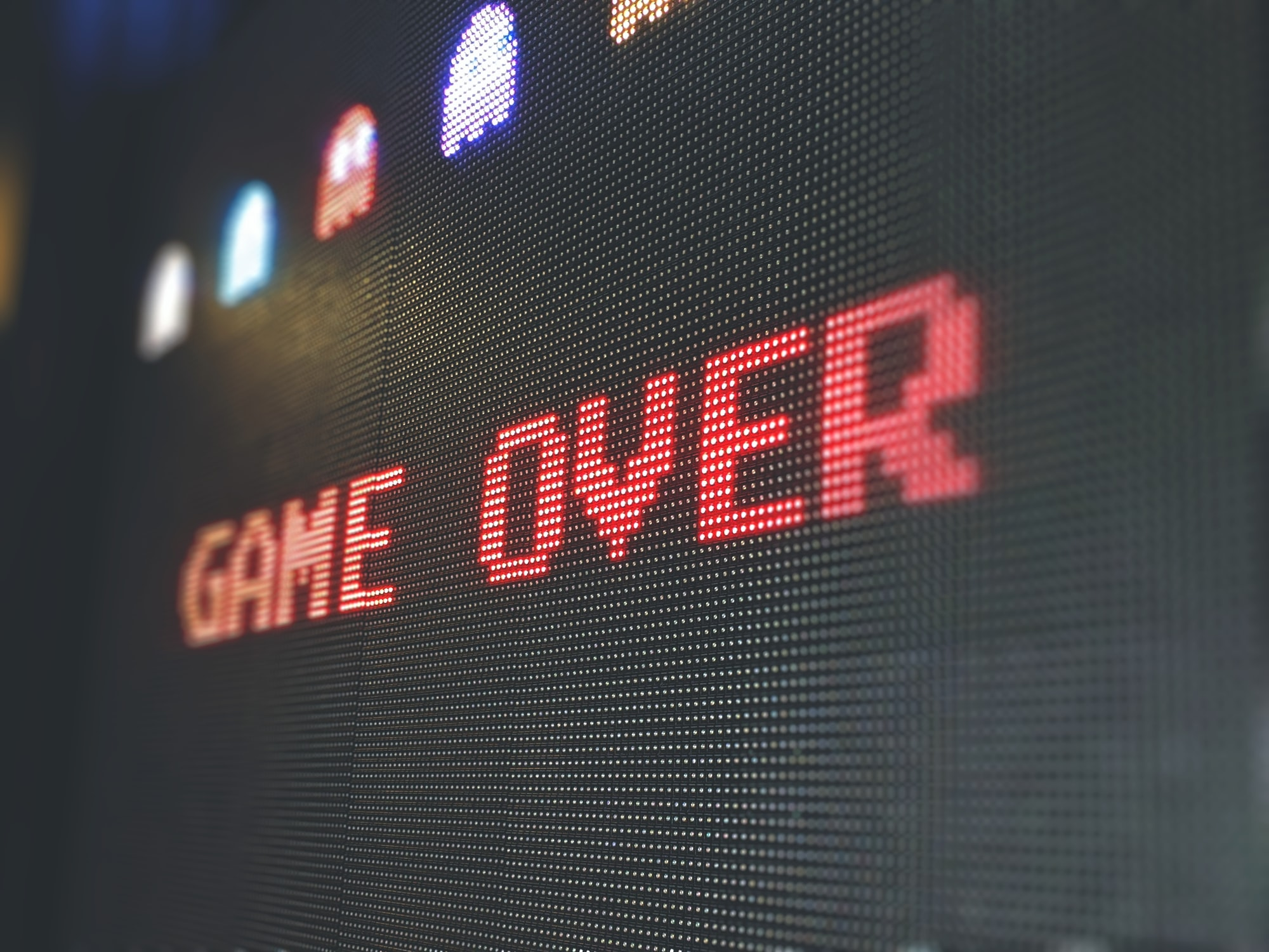 Pixelated Game Over screen on an oversized PAC-MAN arcade machine