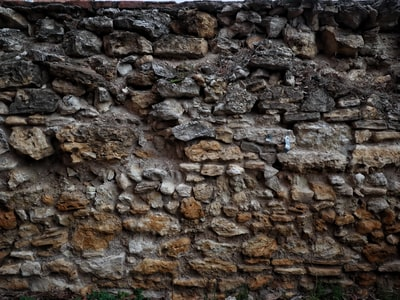 brown and gray rock wall blarney stone teams background