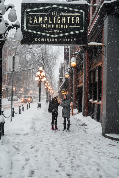 Two girls sharing a snack on a snowy day in Vancouver