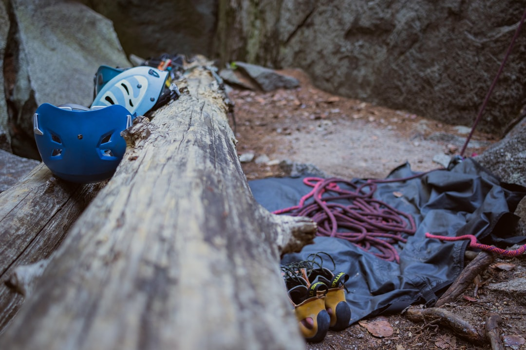 Climbing Gear and Ropes Next A Log - unsplash