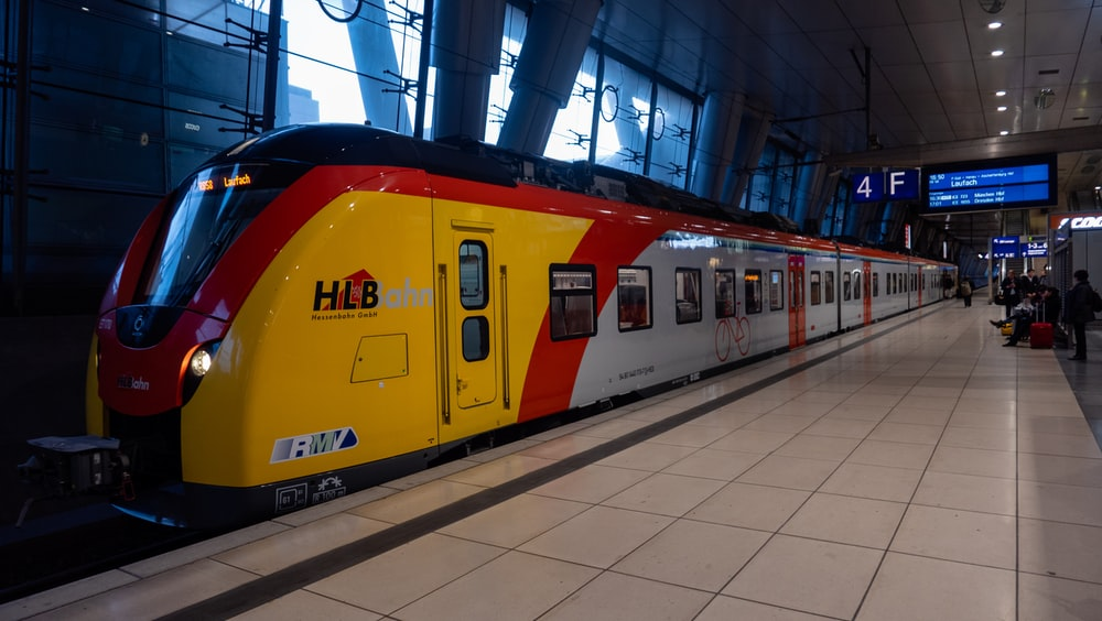 yellow and red train in train station