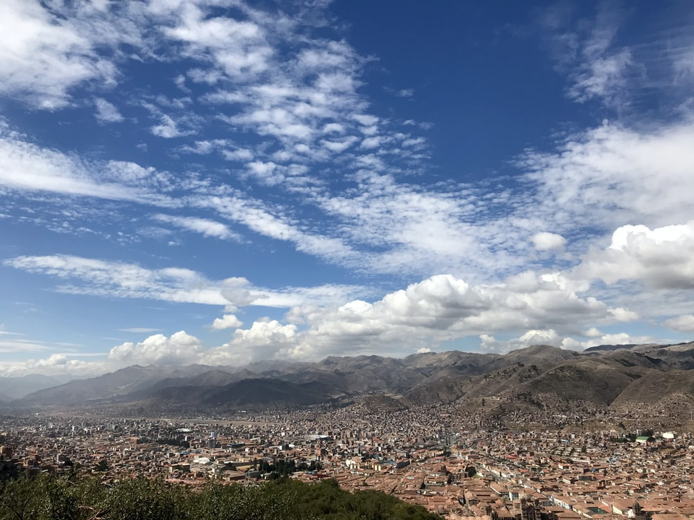 brown mountains under blue sky and white clouds during daytime