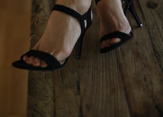 woman in black peep toe sandals