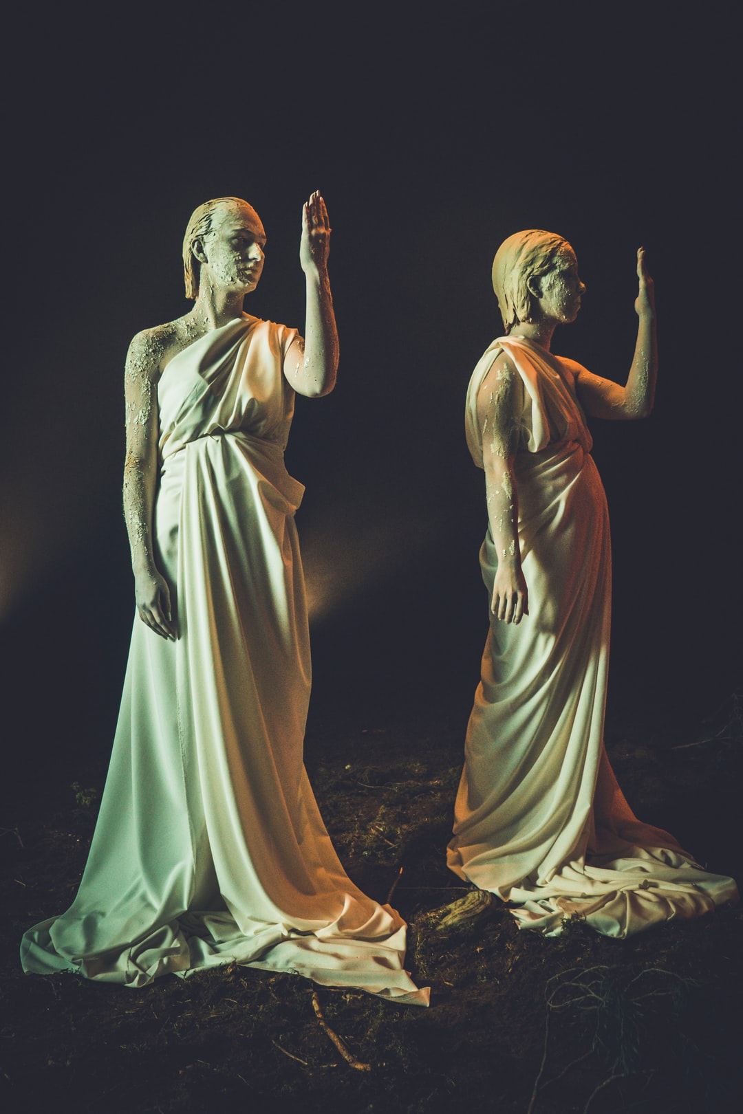 Two female roman antique sculpture characters performance