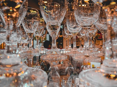 clear wine glasses on table glass teams background
