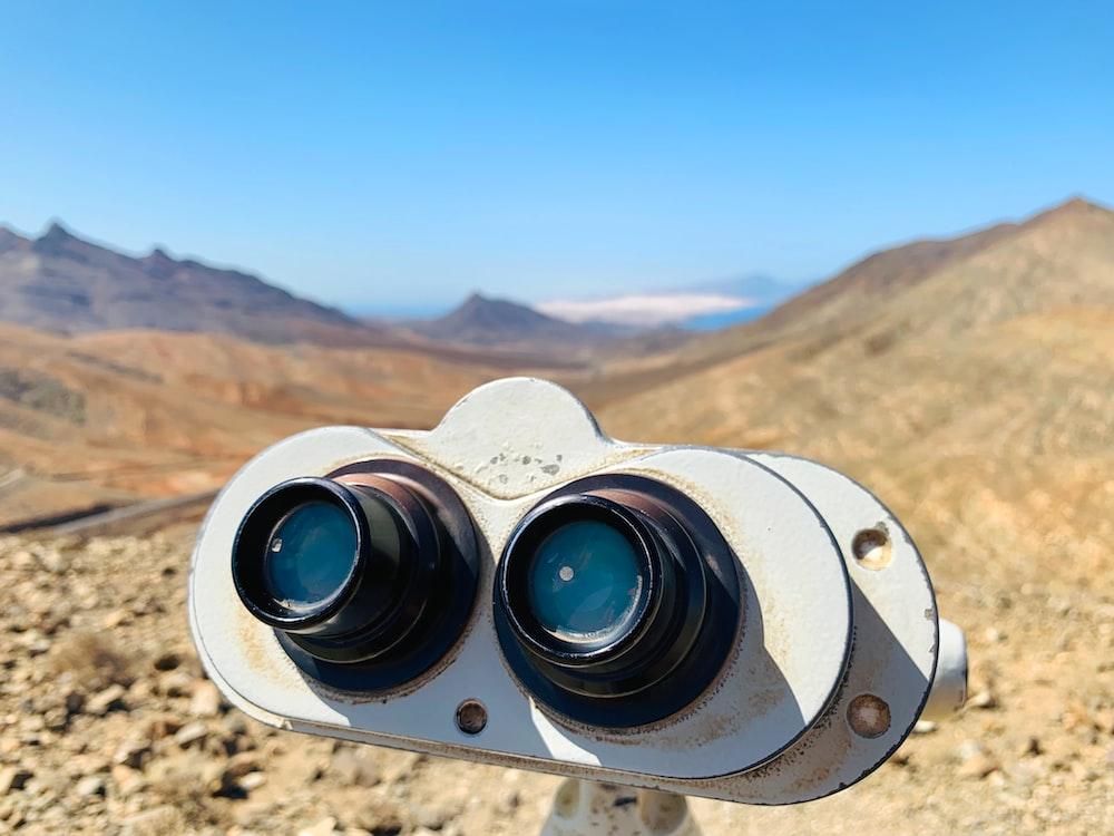 white binoculars on brown rock formation during daytime