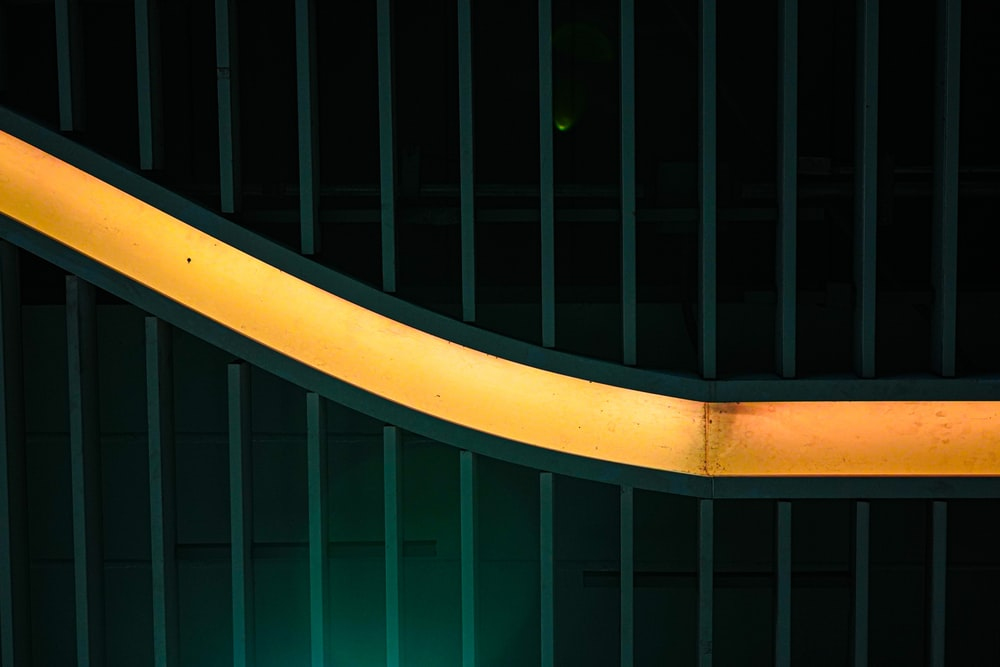 green metal fence with yellow metal railings