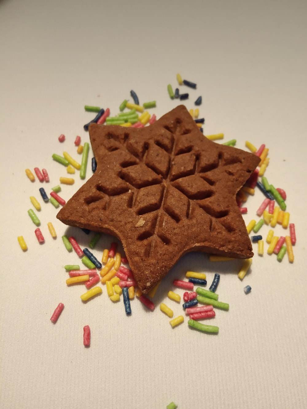 brown star shaped cookie on white surface