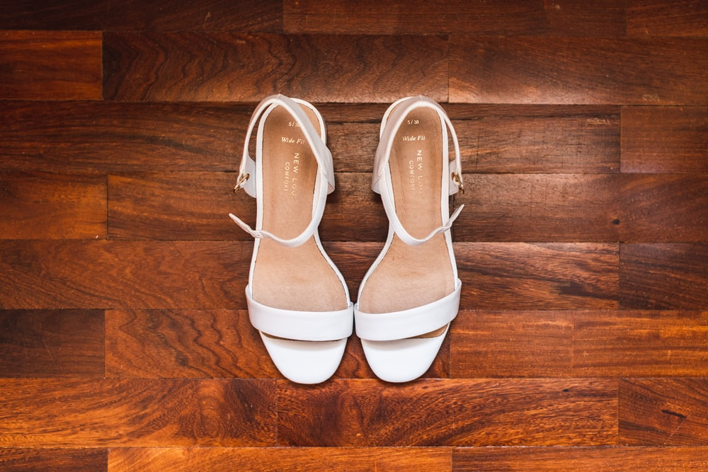 white and brown leather shoes
