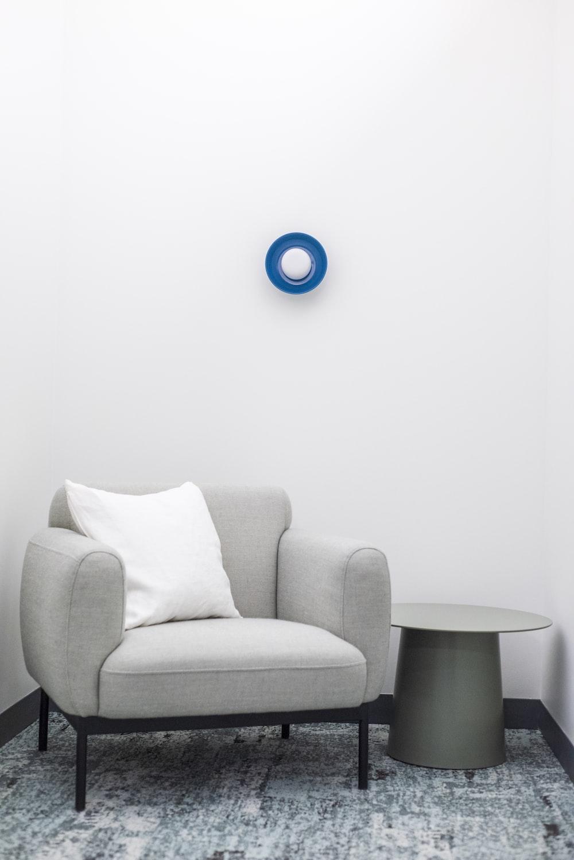 blue round ball on grey sofa