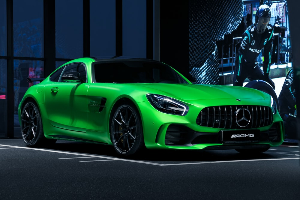green mercedes benz coupe parked on parking lot