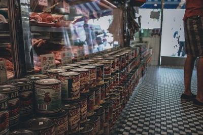 brown and white labeled cans on display counter