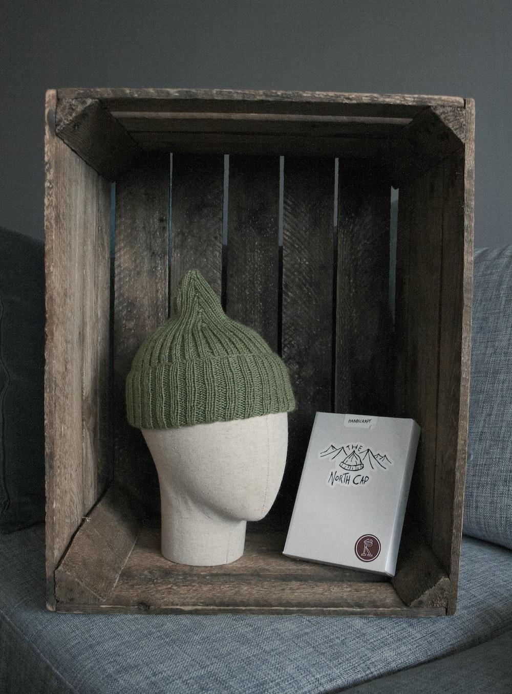 green yarn on white paper